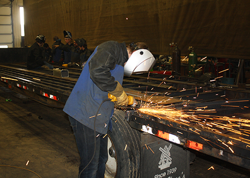 Northwest Iowa Community College Production Welding student grinding down a finished weld.<br>
